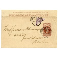 1890 ½d brown postal stationery wrapper  to Berlin from London up-rated bisected 1d lilac  to pay the 1d rate